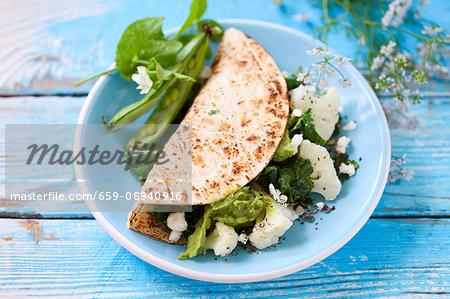 Tortilla with cauliflower, fava beans and avocado