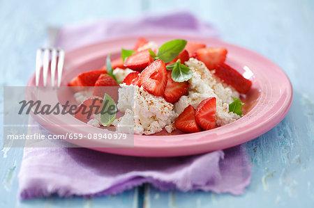 Quark with fresh strawberries, basil and cinnamon