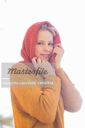 Portrait of a pretty blonde woman in park in autumn