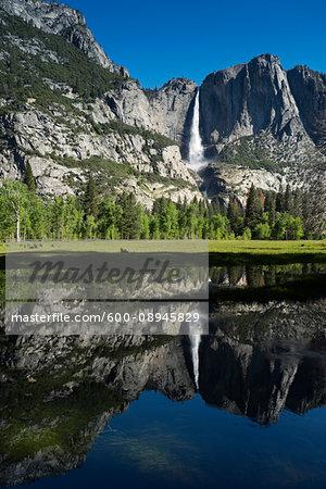 Yosemite Falls reflected in Merced River in Yosemite National Park in California, USA