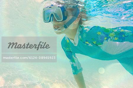 Boy snorkeling underwater