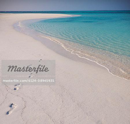 Footprints in sand on tropical beach
