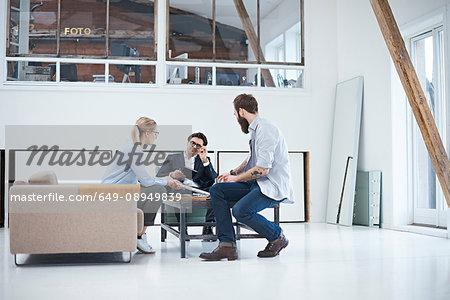 Design team meeting on design studio sofa