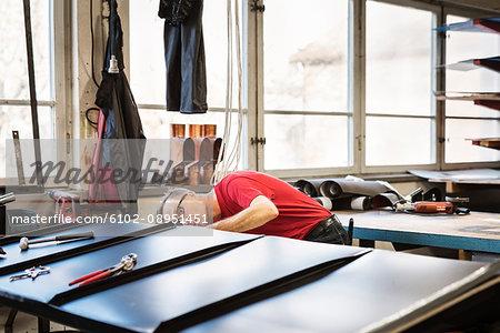 Tinnsmith working in a workshop