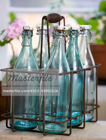 Bottles in metal rack