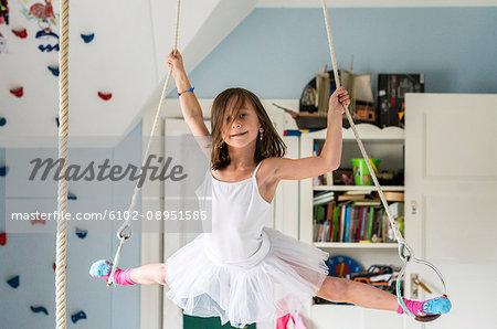 Girl doing splits while hanging