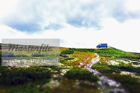 Van parked in remote landscape