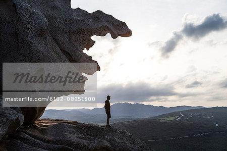 Hiker looking at view