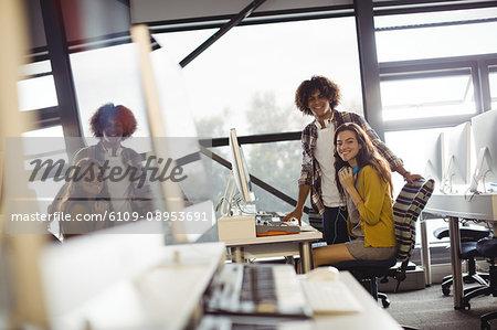 Audio engineers working over computer in recording studio