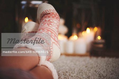 Feet of woman wearing festive socks