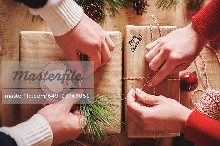 Couple wrapping christmas presents