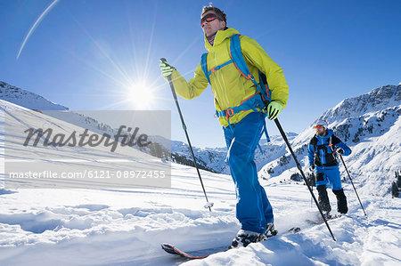 Skiers walking on snow mountain
