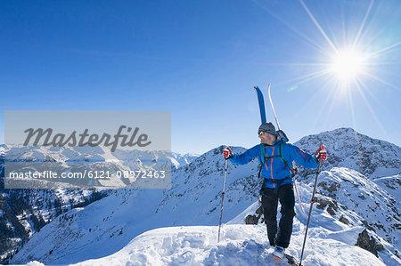 Skier on ridge of snow mountain
