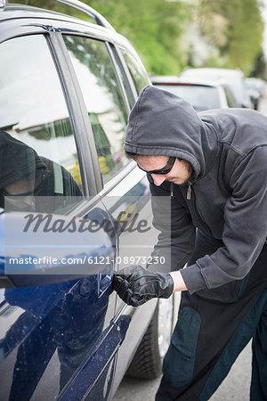 Thief unlocking car door