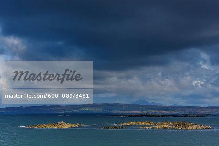 Scottish coast with dark clouds over the ocean at Mallaig in Scotland, United Kingdom