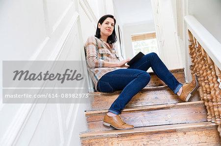 Female designer contemplating on creative studio stairway