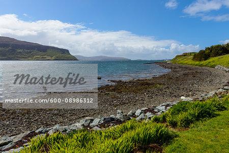 Shingle beach and coastal landscape on the Isle of Skye in Scotland, United Kingdom
