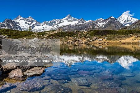 The Swiss Alps reflected in the small mountain lake of Grunsee at Zermatt, Switzerland