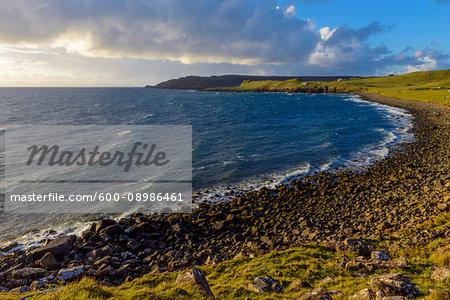 Rocky beach and sea cliffs along the coast of the Isle of Skye in Scotland, United Kingdom