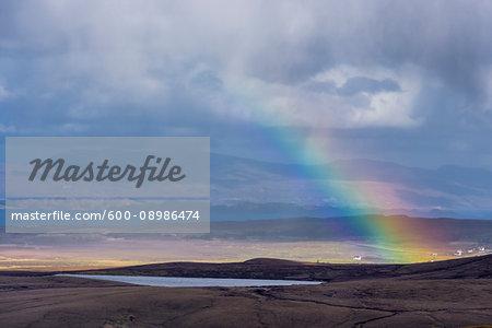 Rainbow over the Highlands landscape on the Isle of Skye in Scotland, United Kingdom