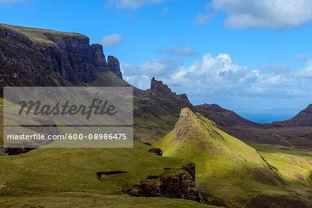 Grassy cliffs and mountain landscape on the Trotternish Peninsula on the Isle of Skye, Scotland, United Kingdom