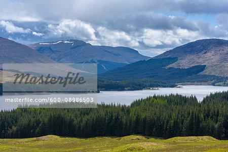 Scenic landscape of hills and a Scottich loch in springtime in Scotland, United Kingdom