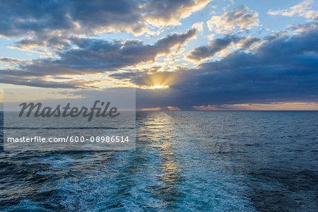 Ship's wake at sunset over the North Sea, United Kingdom