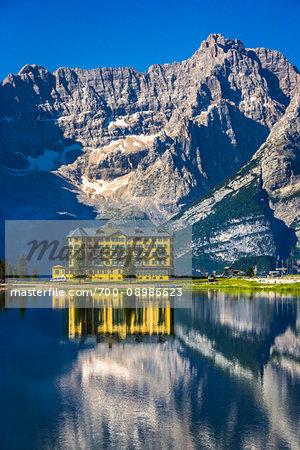 Grand Hotel Misurina reflected in Lake Misurina on a sunny day in the Dolomites in Veneto, Italy