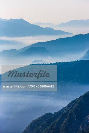 Misty fog over the Dolomites near The Three Peaks of Lavaredo (Tre Cime di Lavaredo), Auronzo di Cadore, Italy
