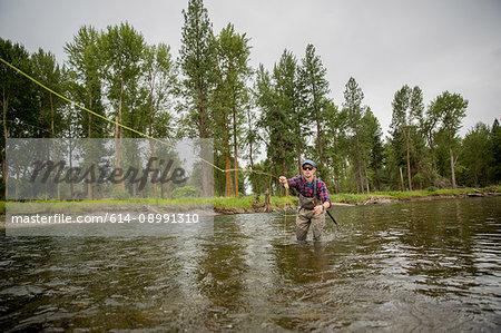 Man fishing in river, Clark Fork, Montana and Idaho, US