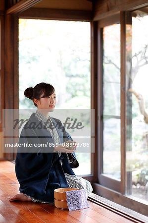 Japanese woman wearing a yukata at traditional ryokan, Tokyo, Japan
