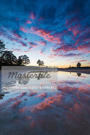 Scenic sunset at lake