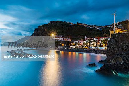 Illuminated town at bay