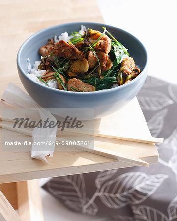 Bowl of pork stir fry with rice
