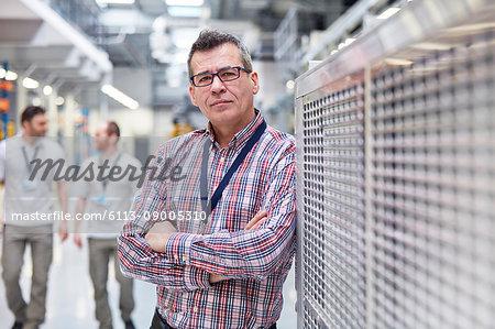 Portrait confident male supervisor in factory