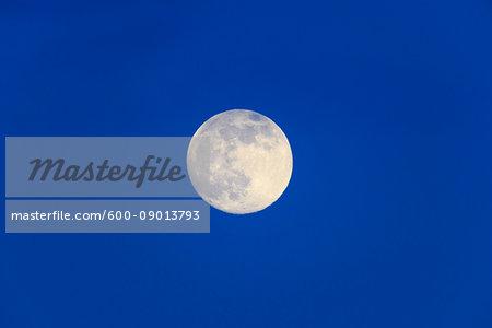 Full moon in a dark blue sky over Austria
