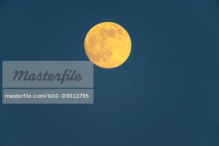 Full moon in a night blue sky over Burgenland in Austria