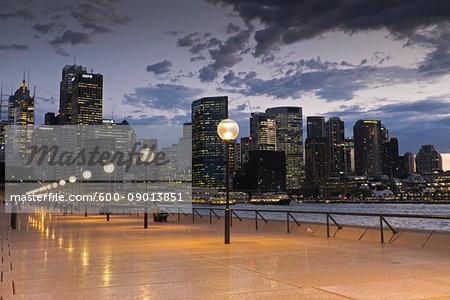 Seaside Promenade and Sydney skyline at dusk at the Circular Quay in Australia