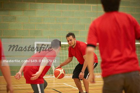 Students playing basketball