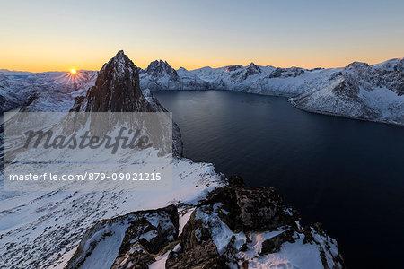 View of Mount Segla and frozen sea along the Mefjorden from peak Hesten at dawn Senja Norway Europe