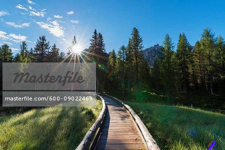 Lago Antorno with boardwalk and morning sun at Misurina in the Gruppo dei Cadini in Veneto, Italy