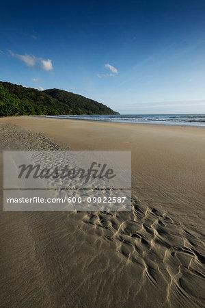 Patterns in wet sand on beach at Cape Tribulation in Queensland, Australia