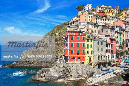 Colourful buildings on cliff side, Riomaggiore, Liguria, Italy, Europe