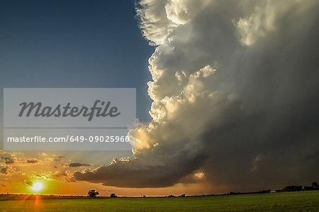 Low-precipitation supercell spiralling gracefully as the sun sets on the horizon, Chickasha, Oklahoma, USA