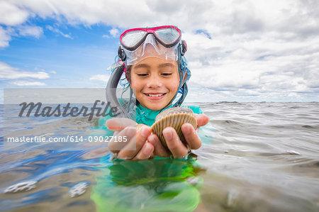 Girl holding fresh caught scallops
