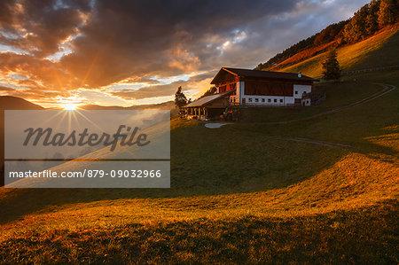Last ray on a farm in the Funes valley, Coll, Santa Magdalena, South Tyrol region, Trentino Alto Adige, Bolzano province, Italy, Europe