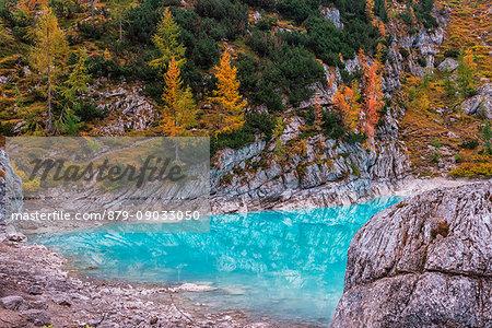 Italy, Veneto, Cortina d'Ampezzo, autumn reflections at Sorapiss Lake