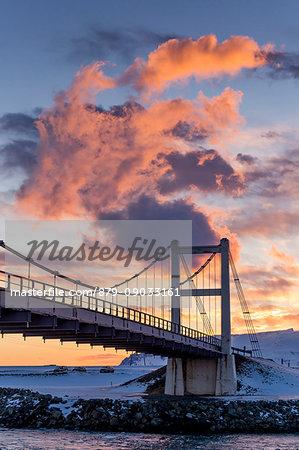 Sunset on the Jokulsarlon lagoon bridge,southern Iceland,Europe