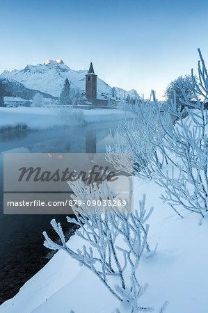 Foggy sunrise in winter. Sils Maria, Sils im Engadin, Graubunden, Switzerland.