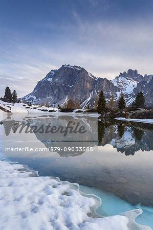 Europe, Italy, Veneto, Falzarego, Belluno. Spring thaw at the Lake of Limedes, on the background Lagazuoi and Fanis, Dolomites